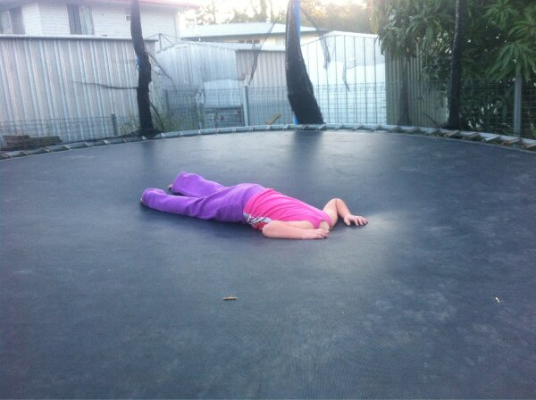 Headless person on trampoline