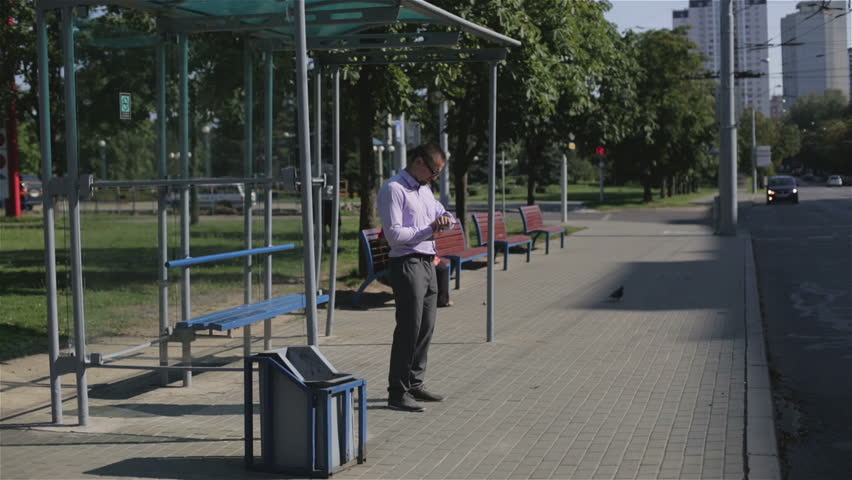 A man standing at a bus stop w... | Jokes of the day (57233)